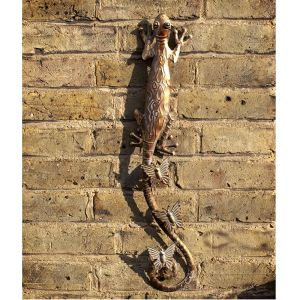 gold metal lizard wall art