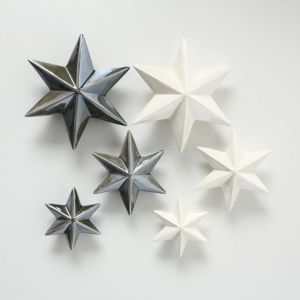 Pearly white ceramic stars wall set of 3. Buy stars at PurpleSunrise.com Southend